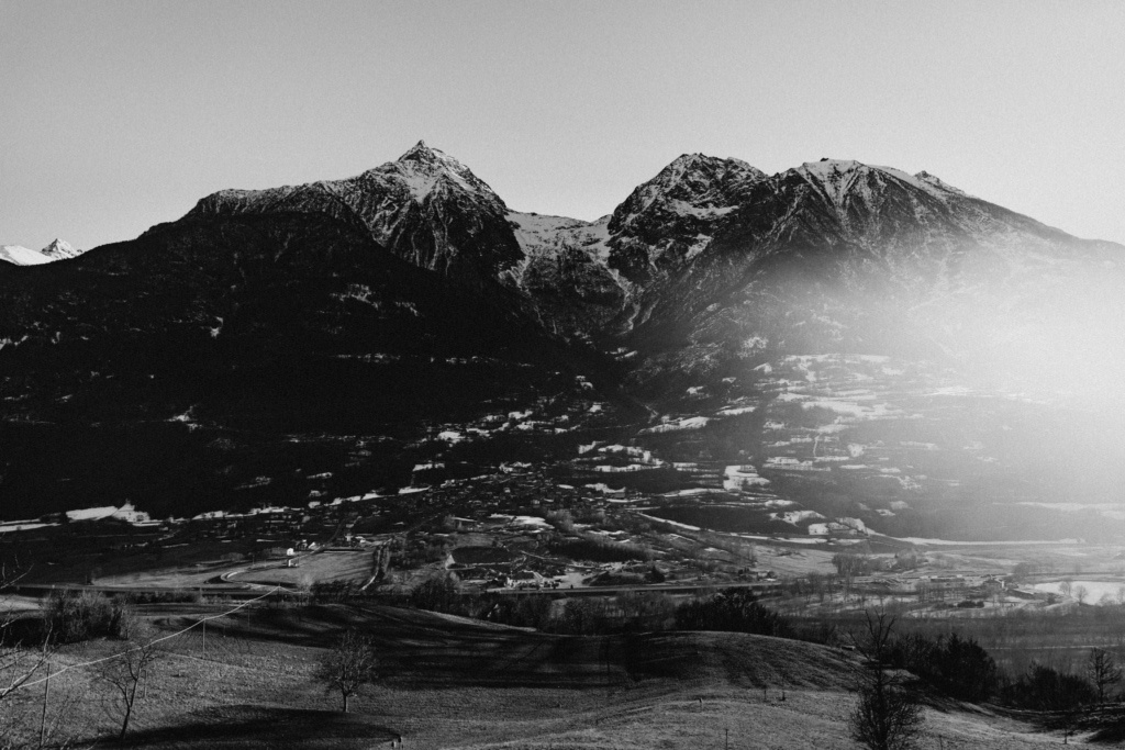 Black and white view of the snow-sprinkled Aosta Valley in the late winter