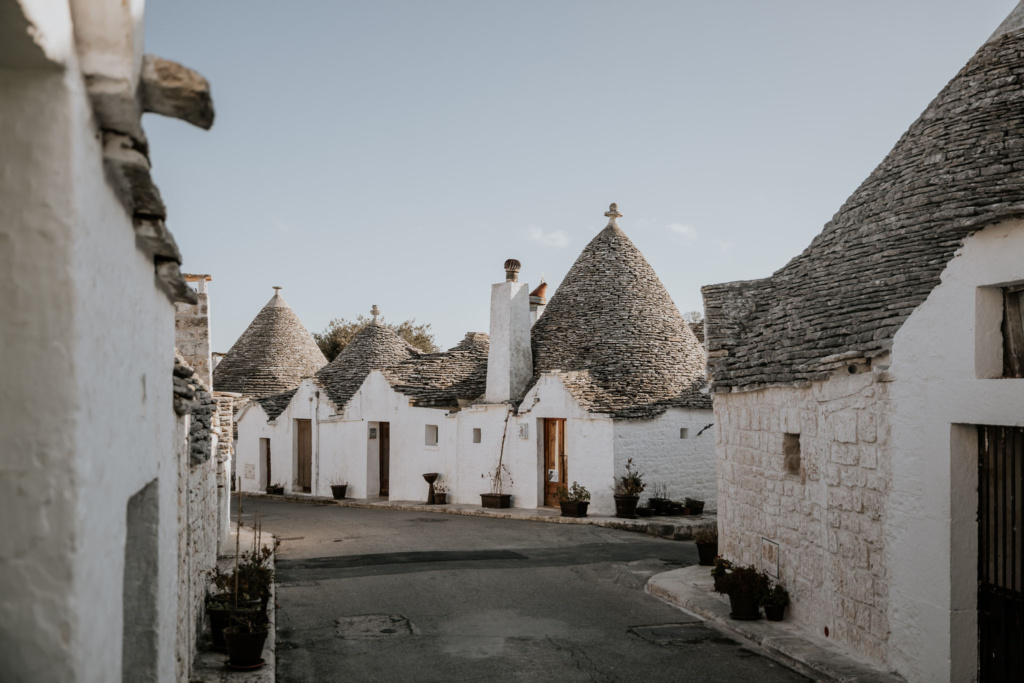 The conical stone roofs and white limestone brick of the traditional trulli houses in Alberobello, Italy.