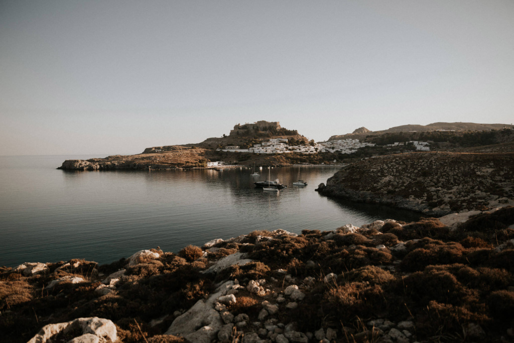 View of an autumnal harbour with boats and a small coastal village - Lindos, Rhode Island