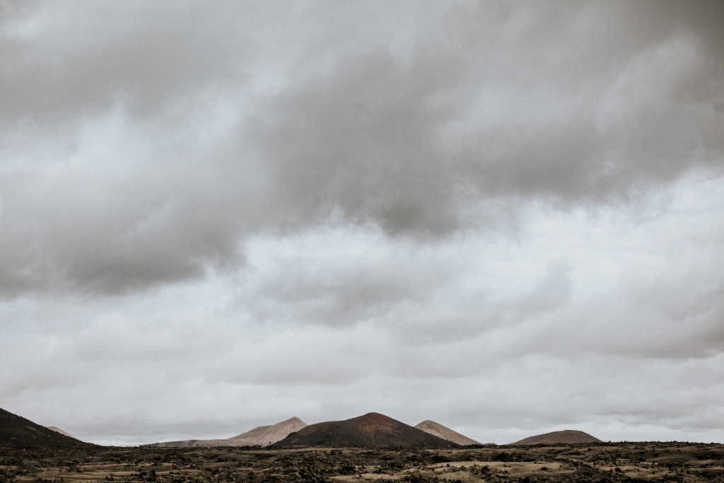 Dramatic volcanic landscape and cloudy skies in Lanzarote, the dream winter elopement destination