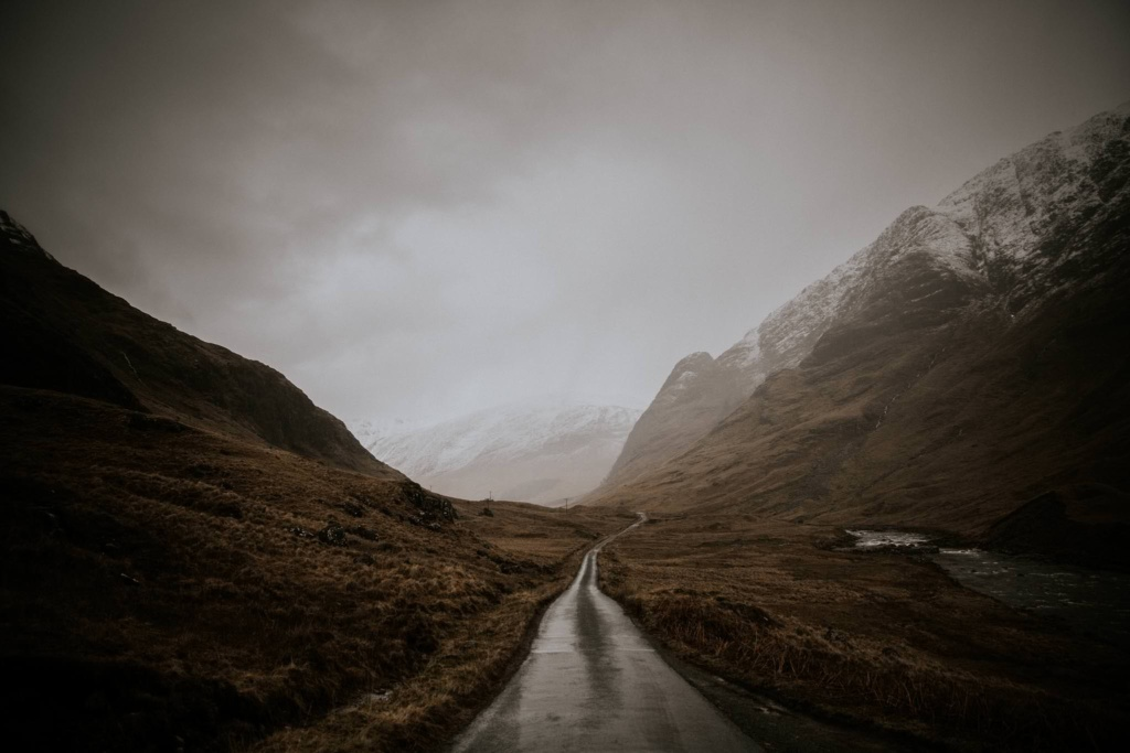 A gloomy winding road in Glen Etive in the Highlands of Scotland