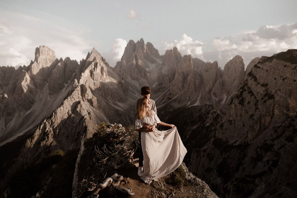 The Dolomite mountains of the Cadini di Misurina are truly breathtaking at sunset, and so is the eloping couple on this outcrop in front of them