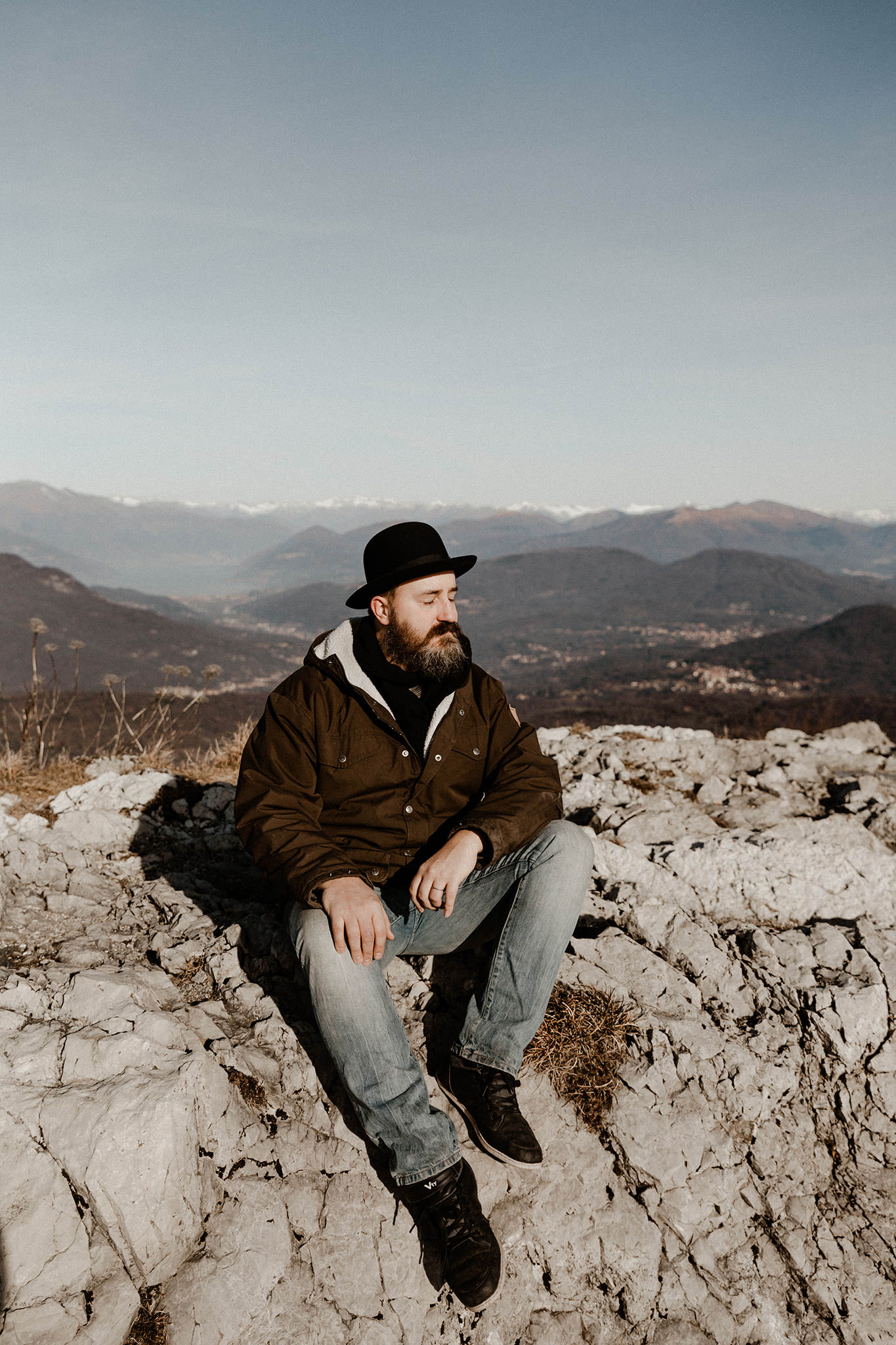 Here we see half of our team sitting on a hill near Varese, with the high Alps behind him