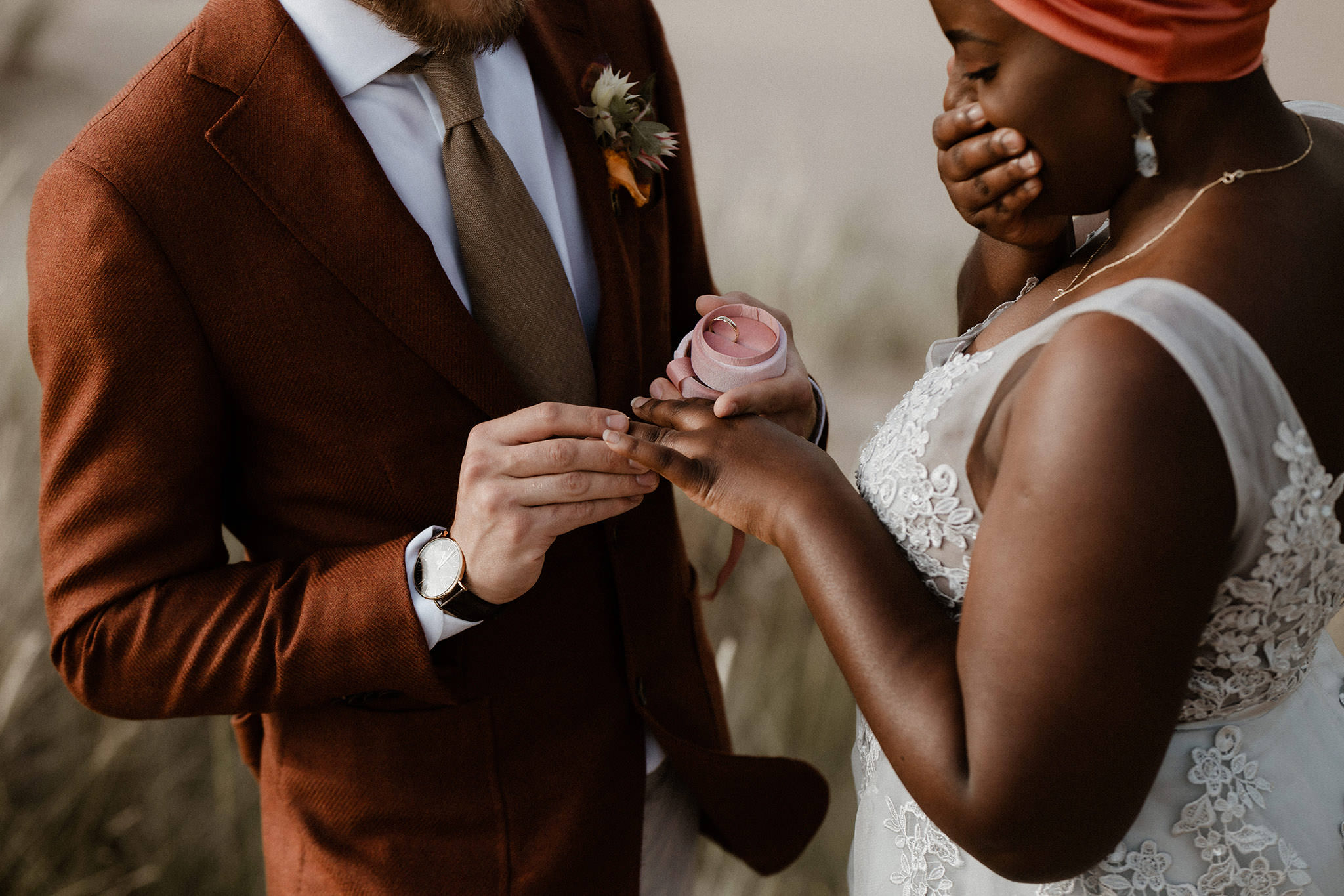 A beautiful bride has all the emotions as her groom slips the wedding ring on her finger