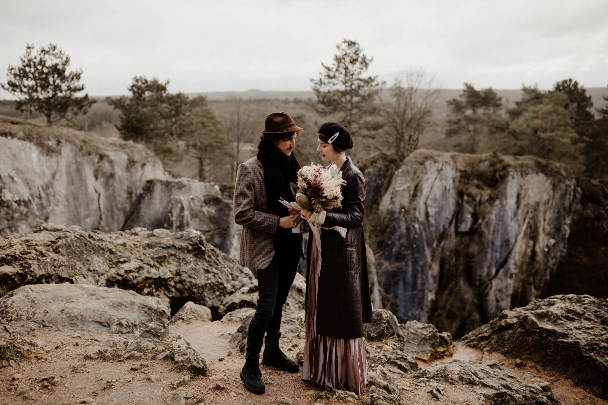 Standing at a cliff in the Ardennes, a couple reads their vows to each other
