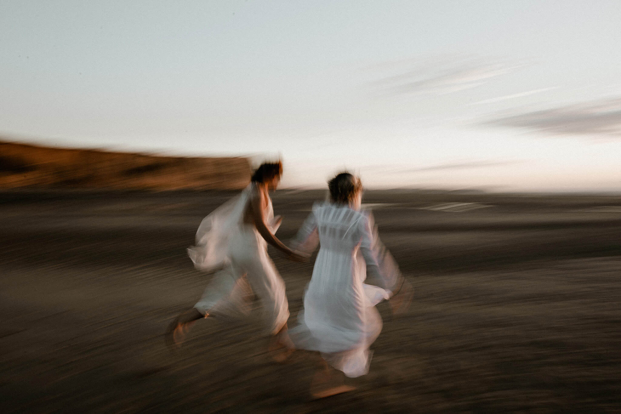 These eloping damsels have the time of their life, running on the French beach near Cape Gris-Nez